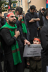 Muslim community Bradford UK. 2019 2010s. Day of Ashura parade Shia Muslims remember the martyrdom of Hussain, who was killed in the desert of Karbala in today's Iraq in A.D. 680. Shiite Muslims believe that Hussain was their third imam – a line of 12 divinely appointed spiritual and political successors.