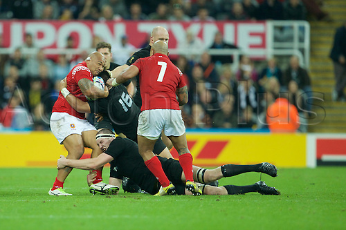 09.10.2015. St James Park, Newcastle, England. Rugby World Cup. New Zealand versus Tonga. Tonga prop Sona Taumalolo is tackled by New Zealand All Black hooker Keven Mealamu.