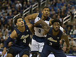 Akron's Tyler Cheese (4) and Daniel Utomi (3) fight for a rebound with Nevada's Tre'Shawn Thurman (0) in the first half of an NCAA college basketball game in Reno, Nev., Saturday, Dec. 22, 2018. (AP Photo/Tom R. Smedes)