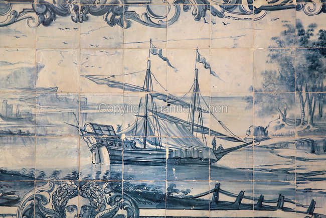 Sailing ship, traditional blue and white azulejos tile scene, 18th century, part of a series depicting the history of the monastery and the Siege of Lisbon in 1147, in the Monastery of Sao Vicente de Fora, an Augustinian order monastery and church built in the 17th century in Mannerist style, Lisbon, Portugal. The monastery also contains the royal pantheon of the Braganza monarchs of Portugal. Picture by Manuel Cohen