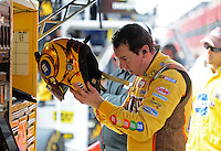Oct. 11, 2009; Fontana, CA, USA; NASCAR Sprint Cup Series driver Kyle Busch takes off his helmet after being pulled from his car due to flu like symptoms during the Pepsi 500 at Auto Club Speedway. Mandatory Credit: Mark J. Rebilas-