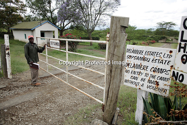 A security guard stands at the gate at Soysambu farm. Photo: Per-Anders Pettersson/ Getty Images