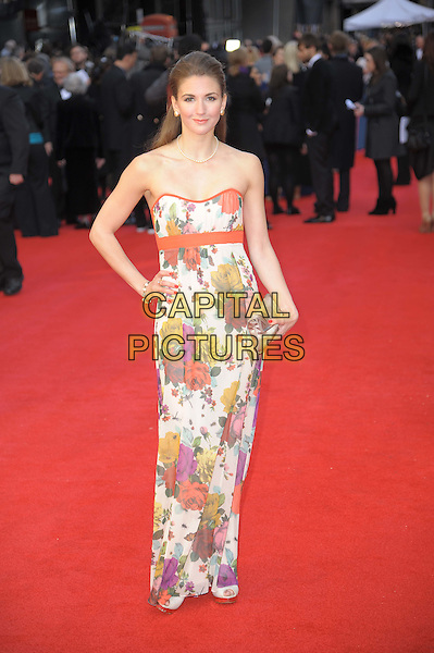 Summer Strallen.The Olivier Awards 2012, Royal Opera House, Covent Garden, London, England..April 15th, 2012.full length dress white orange trim floral print red yellow purple pink hand on hip.CAP/CAS.©Bob Cass/Capital Pictures.
