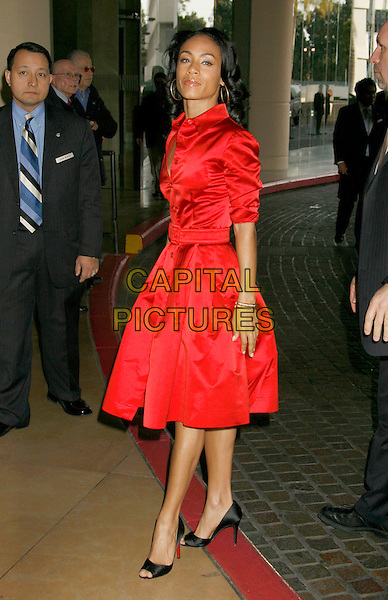 JADA PINKETT SMITH .79th Annual Academy Awards Nominees Luncheon held at the Beverly Hilton Hotel, Beverly Hills, California, USA,.05 February 2007..full length red shirt dress gold hoop earrings black bag Christian Louboutin shoes .CAP/ADM/RE.©Russ Elliot/AdMedia/Capital Pictures.