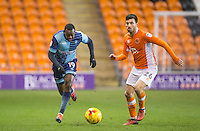 Myles Weston of Wycombe Wanderers and Michael Cain of Blackpool during the The Checkatrade Trophy match between Blackpool and Wycombe Wanderers at Bloomfield Road, Blackpool, England on 10 January 2017. Photo by Andy Rowland / PRiME Media Images.