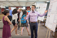 "Angus McDonald '16 talks about his research project, ""Optimizing of the Reversible Adsorption of Gold Nanoparticles using Chitosan-Functionalized Iron- Oxide Nanoparticles"" with Laila Hamzai '17. After researching all summer, Occidental College students present their work at the annual Summer Undergraduate Research Conference on July 29, 2015.<br /> (Photo by Marc Campos, Occidental College Photographer)"