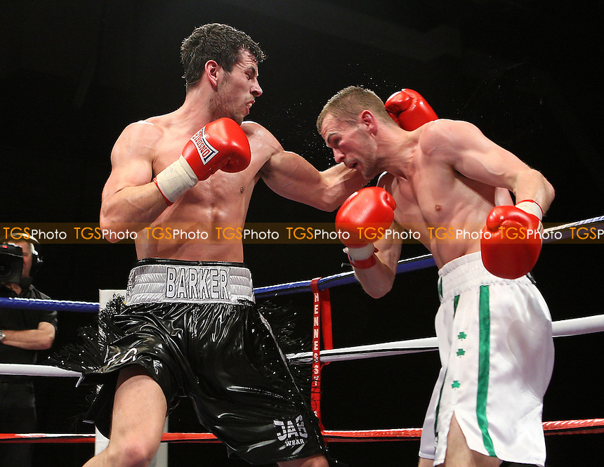 Darren Barker (Barnet, black shorts) defeats Jason McKay (Banbridge, white shorts) in a Middleweight boxing contest for the Commonwealth Title at the Brentwood Centre, Essex promoted by Hennessy Sports -  13/12/08 - MANDATORY CREDIT: Gavin Ellis/TGSPHOTO - Self billing applies where appropriate - Tel: 0845 094 6026