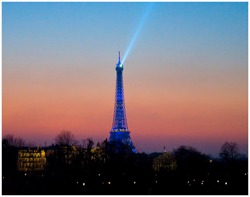 View of the Eiffel Tower, looking west just after sunset