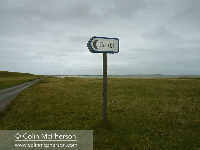 A road sign pointing towards the the village of Gott which lies on the edge of Gott Bay, on the island of Tiree on Scotland's west coast.