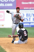Richmond Flying Squirrels infielder  Ehire Adrianza (1) tries to avoid New Britain Rock Cats base runner Danny Santana (9) while completing a double play during game played at New Britain Stadium on May 30, 2013 in New Britain, CT.  New Britain defeated Richmond 2-1.  (Tomasso DeRosa/Four Seam Images)