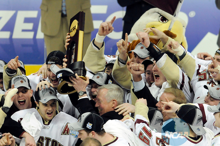 12 APR 2008: Boston College head coach Jerry York holds up the championship trophy following the Division I Men's Ice Hockey Championship held at the Pepsi Center in Denver, CO. Boston College defeated Notre Dame 4-1 to claim the championship title. Ryan McKee/NCAA Photos