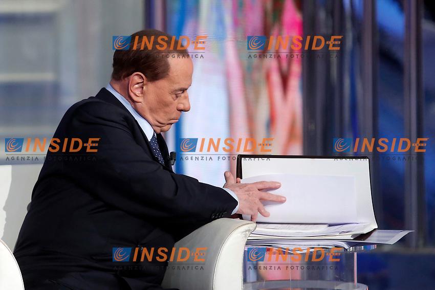 Silvio Berlusconi looks for his papers to explain the program for his electoral campaign<br /> Roma 11/01/2018. Trasmissione tv Rai 'Porta a Porta'.<br /> Rome January 11th 2018. Silvio Berlusconi appears as a guest on the talk show 'Porta a Porta' in Rome<br /> Foto Samantha Zucchi Insidefoto