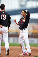 Quad Cities River Bandits shortstop Antonio Nunez (6) talks with Kyle Talker (19) in between innings during a game against the Burlington Bees on May 9, 2016 at Modern Woodmen Park in Davenport, Iowa.  Quad Cities defeated Burlington 12-4.  (Mike Janes/Four Seam Images)