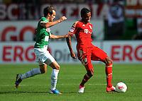 Fussball 1. Bundesliga :  Saison   2012/2013   1. Spieltag  25.08.2012 SpVgg Greuther Fuerth - FC Bayern Muenchen Stephan Fuerstner (li, Greuther Fuerth) gegen Jerome Boateng (FC Bayern Muenchen)