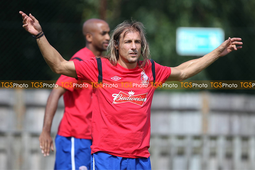 World Cup Winner Claudio Caniggia warms up to play for Wembley FC - Uxbridge vs Wembley - FA Cup Preliminary Round Football at Honeycroft, Uxbridge, Middlesex - 26/08/12 - MANDATORY CREDIT: Andy Nunn/TGSPHOTO - Self billing applies where appropriate - 0845 094 6026 - contact@tgsphoto.co.uk - NO UNPAID USE.