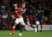Lyle Taylor of Charlton Athletic and Nottingham Forest's Joe Worrall challenge for the ball during Charlton Athletic vs Nottingham Forest, Sky Bet EFL Championship Football at The Valley on 21st August 2019