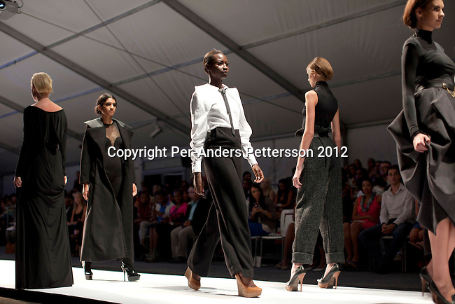 JOHANNESBURG, SOUTH AFRICA  MARCH 10: Models walk during the show with designer label Avant at the Joburg Fashion Week on March 10, 2012, at the Hyde Park Mall in Johannesburg, South Africa. South Africa's finest designers showed their 2012 Autumn & Winter collections during the 4-day event. (Photo by Per-Anders Pettersson)