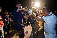 Alcuni clandestini provenienti dall'Africa vengono soccorsi da una motovedetta della Capitaneria di Porto al largo dell'isola di Lampedusa. An illegal immigrant rescue by Italian Coast Guard