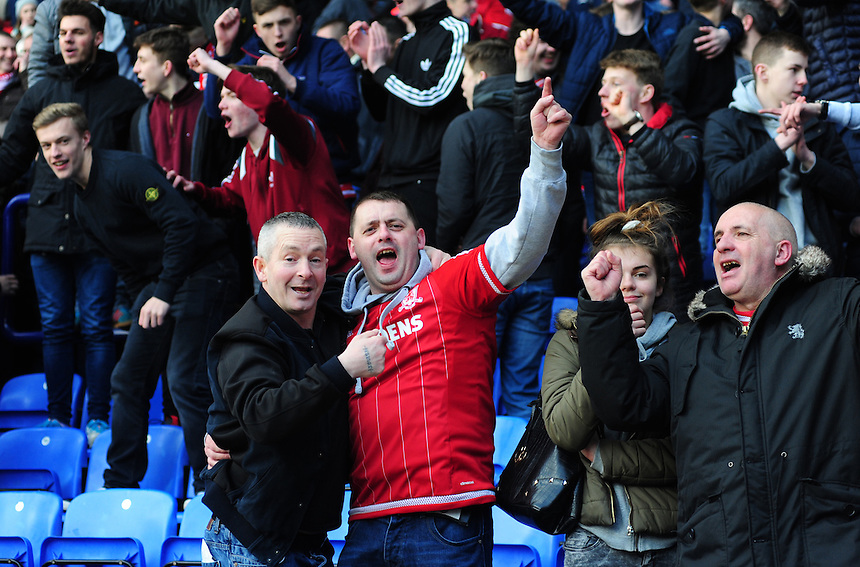 Middlesbrough fans celebrate at the end of the game<br /> <br /> Photographer Chris Vaughan/CameraSport<br /> <br /> Football - The Football League Sky Bet Championship - Bolton Wanderers v Middlesbrough - Saturday 16th April 2016 - Macron Stadium - Bolton<br /> <br /> &copy; CameraSport - 43 Linden Ave. Countesthorpe. Leicester. England. LE8 5PG - Tel: +44 (0) 116 277 4147 - admin@camerasport.com - www.camerasport.com