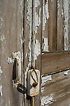 handle on an old door with peeling paint
