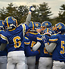Kellenberg teammates celebrate after their 41-6 wn over Xavier (Manhattan) in the NYCHSFL Class AA final at Mitchel Athletic Complex in Uniondale on Saturday, Nov. 17, 2018.
