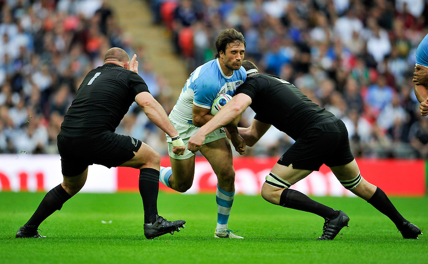 Argentina's Marcelo Bosch is tackled by New Zealand's Tony Woodcock (left) and Kieran Read<br /> <br /> Photographer Ashley Western/CameraSport<br /> <br /> Rugby Union - 2015 Rugby World Cup - New Zealand v Argentina - Sunday 20th September 2015 - Wembley Stadium - London <br /> <br /> &copy; CameraSport - 43 Linden Ave. Countesthorpe. Leicester. England. LE8 5PG - Tel: +44 (0) 116 277 4147 - admin@camerasport.com - www.camerasport.com