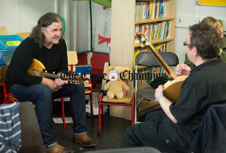 "Tam Patterson and Chris Ward, of St James The Great CCE, Glasgow, getting in some last minute practice  before competition ""watched"" by Bella Bear during Fleadh Cheoil na hEireann in Ennis. Photograph by John Kelly."