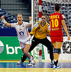 BELGRADE, SERBIA - DECEMBER 16:  Heidi Loke (L) of Norway celebrates the goal near goalkeeper Sonja Barjakratovic of Montenegro (C) during the Women's European Handball Championship 2012 gold medal match between Norway and Montenegro at Arena Hall on December 16, 2012 in Belgrade, Serbia. (Photo by Srdjan Stevanovic/Getty Images)