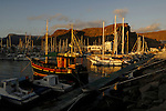 Jetty and boats in Puerto Mogan Harbour, at dusk, Gran Canaria. Canary Islands
