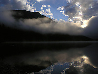 Morning mist and clouds on Quartz Lake in Glacier Park, Montana. Photo by Jason Cohn