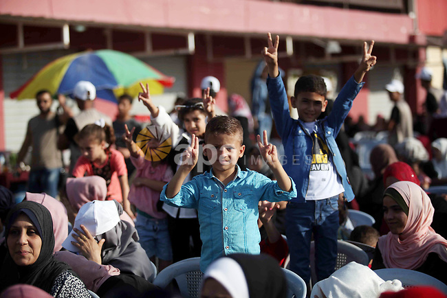Palestinians attend a community reconciliation festival, in Gaza city, on June 20, 2019. The Committee for Community Reconciliation decided to spend $50,000 for the families of martyrs of the political division. Photo by Mahmoud Ajjour