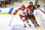 19 MAR 2016: The Division lll Women's Ice Hockey Championship is held at the Ronald B. Stafford Ice Arena in Plattsburgh, NY. Plattsburgh defeated Wis.-River Falls 5-1 for the national title. Plattsburgh's Julia Duquette #17  Wis.-River Falls' Carly Moran #8 meet along the boards behind the goal in third period action. Nancie Battaglia/NCAA Photos