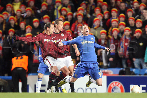 21.02.2013. London, England. Fernando Torres of Chelsea gets brought down Ondrej Svejdik of AC Sparta Prague during the UEFA Europa League, Round of 32,  2nd Leg game between Chelsea and Sparta Prague from Stamford Bridge Stadium......