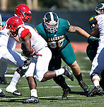 SPEARFISH, SD - SEPTEMBER 17: Jared Tiefenthaler #90 of Black HIlls State closes in on Clifford Simms #22 of Dixie State during their college football game Saturday September 17, 2016 at Lyle Hare Stadium in Spearfish, S.D. (Photo by Dick Carlson/Inertia)