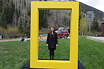 National Geographic Young Explorer and R(e)D Associates consultant Cara Eckholm stands in the yellow border of the National Geographic logo in Telluride, Colorado on May 22, 2015.