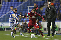Martin Olsson of Swansea City is challenged by Adrian Popa of Reading during the Carabao Cup Third Round match between Reading and Swansea City at Madejski Stadium, Reading, England, UK. Tuesday 19 September 2017