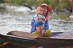 Woman & Son In Dugout Canoe