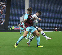 Burnley's James Tarkowski battles with Preston North End's Sean Maguire<br /> <br /> Photographer Mick Walker/CameraSport<br /> <br /> Football Pre-Season Friendly - Preston North End  v Burnley FC  - Monday 23st July 2018 - Deepdale  - Preston<br /> <br /> World Copyright &copy; 2018 CameraSport. All rights reserved. 43 Linden Ave. Countesthorpe. Leicester. England. LE8 5PG - Tel: +44 (0) 116 277 4147 - admin@camerasport.com - www.camerasport.com