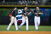 (L-R) Jason Coats (17), Trayce Thompson (15), and Tyler Colvin (26) congratulate each other after their win over the Louisville Bats at BB&T BallPark on May 12, 2015 in Charlotte, North Carolina.  The Knights defeated the Bats 4-0.  (Brian Westerholt/Four Seam Images)