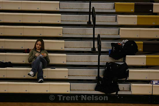 girl with cel phone, sequence receiving a text message? fans. Kaysville - Davis vs. Fremont girls high school basketball, at Davis.