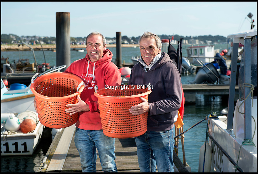 BNPS.co.uk (01202 558833)<br /> Pic: PhilYeomans/BNPS<br /> <br /> Fisherman Mike Bailey & Malcolm Glover.<br /> <br /> The world's largest seahorse has been discovered by a fisherman off the British coast, sparking fresh hope for the threatened mystical creatures.<br /> <br /> The whopping 13-inch spiny seahorse was accidentally hauled in by Michael Bailey while he was out fishing for mullet in Poole Harbour, Dorset.<br /> <br /> Experts say the enormous fish is around twice the average size for the species - and smashes the existing record by almost two inches.