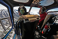 Researchers in helicopter over Lowell Glacier, Kluane National Park, Yukon