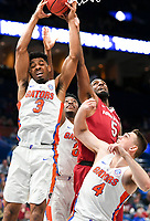 NWA Democrat-Gazette/CHARLIE KAIJO Arkansas Razorbacks forward Arlando Cook (5) reaches for a rebound as Florida Gators cover during the Southeastern Conference Men's Basketball Tournament quarterfinals, Friday, March 9, 2018 at Scottrade Center in St. Louis, Mo.