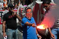 Roma 22 Giugno 2012.Manifestazione  dei sindacati di base contro le politiche economiche e sociali del Governo Monti..Manifestante con la maschera di Mariano Rajoy