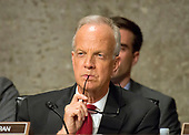 United States Senator Jerry Moran (Republican of Kansas) listens as the US Senate Committee on Commerce, Science, and Transportation conducts hearings to examine the nominations of Ajit Varadaraj Pai, Jessica Rosenworcel, and Brendan Carr, each to be a Member of the Federal Communications Commission on Capitol Hill in Washington, DC on Wednesday, July 19, 2017.<br /> Credit: Ron Sachs / CNP