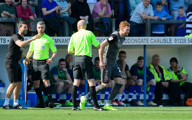 Lincoln City manager Danny Cowley speaks to Referee Lee Mason after he had show Lincoln City's Cian Bolger, right, a yellow card<br /> <br /> Photographer Chris Vaughan/CameraSport<br /> <br /> The EFL Sky Bet League Two - Carlisle United v Lincoln City - Friday 19th April 2019 - Brunton Park - Carlisle<br /> <br /> World Copyright © 2019 CameraSport. All rights reserved. 43 Linden Ave. Countesthorpe. Leicester. England. LE8 5PG - Tel: +44 (0) 116 277 4147 - admin@camerasport.com - www.camerasport.com