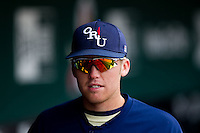Spencer Barnett (2) of the Oral Roberts Golden Eagles in the dugout during a game against the Missouri State Bears on March 27, 2011 at Hammons Field in Springfield, Missouri.  Photo By David Welker/Four Seam Images