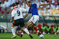 Wayne Rooney of England and Zinedine Zidane of France compete for the ball during the European Championship football match between France and England. France won 2-1 over England .<br /> Lisbon 13/6/2004 Estadio da Luz <br /> Photo Andrea Staccioli Insidefoto