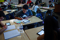 "Lindsay, California, September 5, 2012 - Students in Adrian Gutierrez's Spanish I class use Kindles to do course work. Principal Jaime Robles says that the school used to ban phones and and tablets, but now they embrace them. This is how students communicate and learn. So we are using the tools that they use to keep them engaged.""..Lindsay High School began building a competency-based education model about 7 years ago, fully implementing it just over three years ago and is set to graduate its first class this school year. This model does away with traditional grading and pass/fail for grades. Instead students are expected to achieve proficiency in a range of areas in each class, where a 3 (equal to a traditional B) is passing; A 4 is considered intensive and usually denotes college bound. Says Principal Jaime Robles, ?This allows students to learn at there own pace. If a student is advanced, they can move ahead, and if a student is lagging, they get the support they need.? Part of this model allows for students who are more advanced dig deeper and push harder and truly move ahead of others. Because they are ahead, some spend the extra time learning more, others take concurrent classes at the nearby community college and some choose to graduate early to start their path. ?Each student has their own set of goals,? says English teacher Amalia Lopez, ?Whatever their goals are, we support them.?.Slug: DD_ CompetencyByline: Daryl Peveto / LUCEO for Education Week"