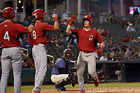 Springfield Cardinals Connor Capel (12) high fives Dylan Carlson (8) and Evan Mendoza (4) during a Texas League game against the Frisco RoughRiders on May 7, 2019 at Dr Pepper Ballpark in Frisco, Texas.  (Mike Augustin/Four Seam Images)